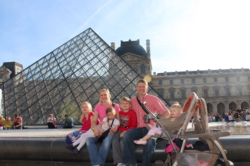My family and I outside the Louvre Museum in Paris, France