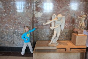 My daughter Katelyn with Cupid at the Louvre