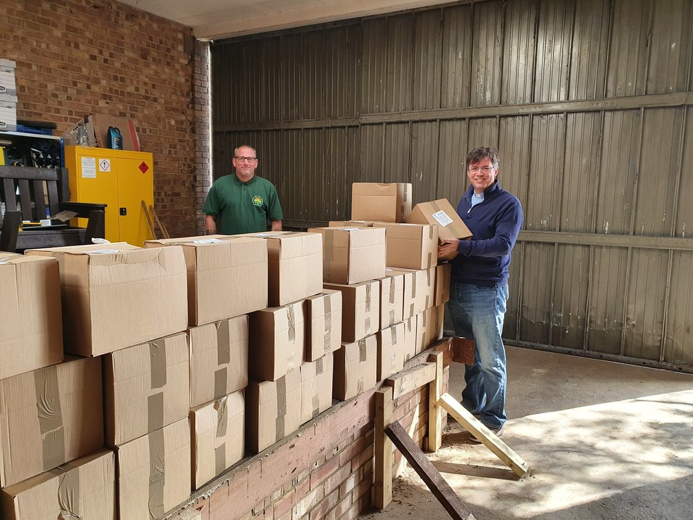 Ranger Dave and Steve from St Frideswides sorting community parcels