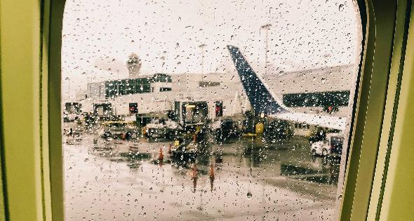 Raindrops on airplane window.